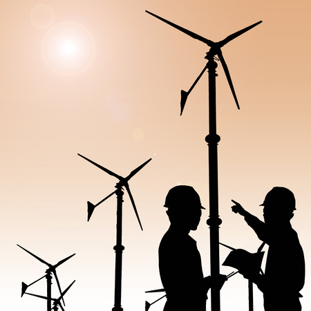 business project: Silhouette of engineers looking at wind turbine site Stock Photo