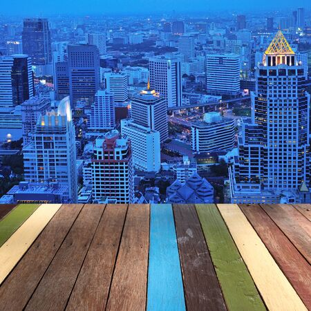 montage: Wood table top on bangkok skyline background montage concept Stock Photo
