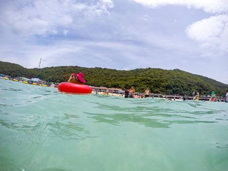 tour operator: PATTAYA, THAILAND - AUGUST 29, 2015:  tourists playing at Tawean beach, in Ko Lan ( Larn Island ) on August 29, 2015 in Pattaya, Thailand.