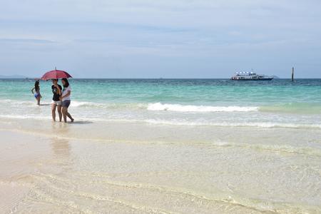 tour operator: PATTAYA, THAILAND - AUGUST 30, 2015:  tourists playing at Samae beach, in Ko Lan ( Larn Island ) on August 30, 2015 in Pattaya, Thailand.