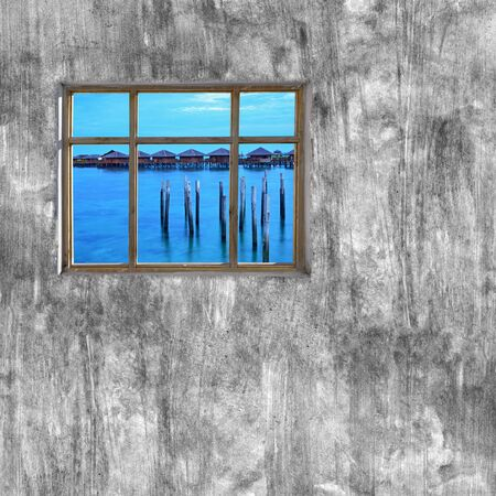 windows frame: windows frame on cement wall and view of tropical sea