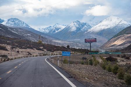Yading, China - October 18, 2015: road along mountain to Yading on October 18, 2015 in Yunnan, China.
