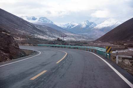 arduous: Yading, China - October 18, 2015: road along mountain to Yading on October 18, 2015 in Yunnan, China.