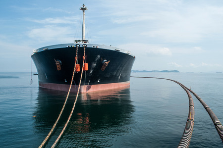 cargo vessel: Oil tanker is transferring oil to the cargo vessel Stock Photo