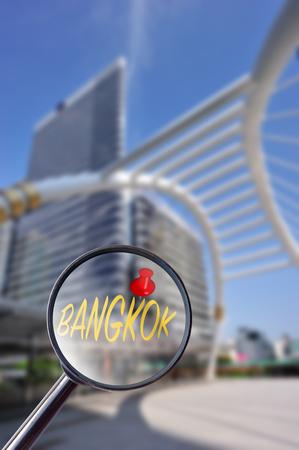 traffic: Magnifying glass searching Bangkok  with bangkok blur background
