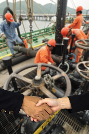 taker: Workers preparing for loading crude oil  form ship to taker in Chonburi. Stock Photo