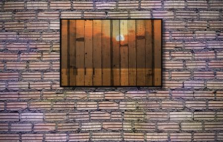 paredes de ladrillos: Marco de fotos en la pared de ladrillo viejo - estilo de época efecto fotos Foto de archivo