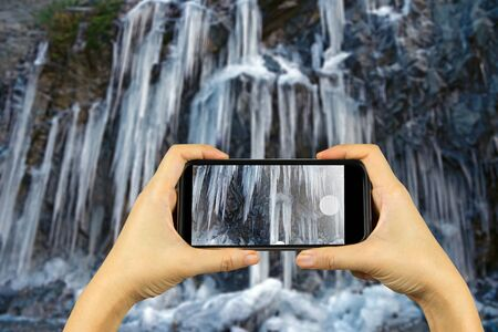 natural ice pastime: Taking photo on smart phone concept.