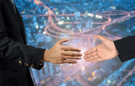 two persons only: Two business men shaking hands