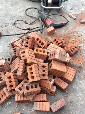 discarded: Pile of discarded bricks from construction site Stock Photo