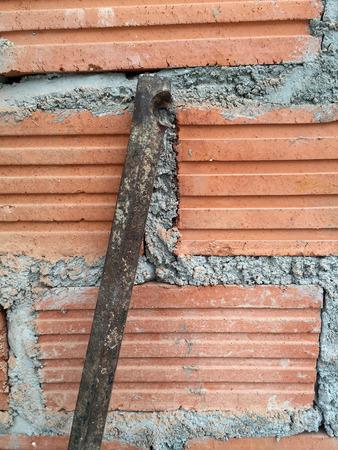 crowbar: crowbar on brick wall