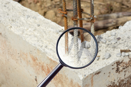 substructure: magnifying glass over The concrete pile at the construction site Stock Photo