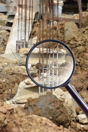 substructure: magnifying glass over concrete pile at the construction site