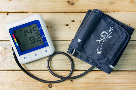 desease: sphygmomanometer on wooden floor