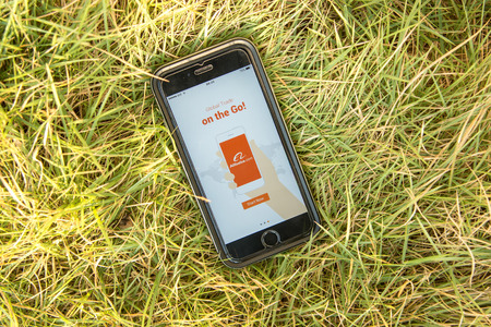 alibaba: NAKORN PATHOM, THAILAND - FEB 15, 2016: top view screen shot of Alibaba app showing on iPhone6 on grass Editorial