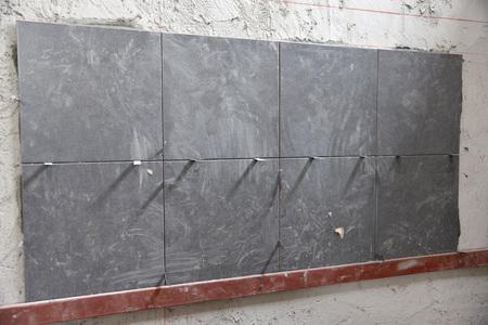 tiled wall: Plasterer tiled wall Stock Photo
