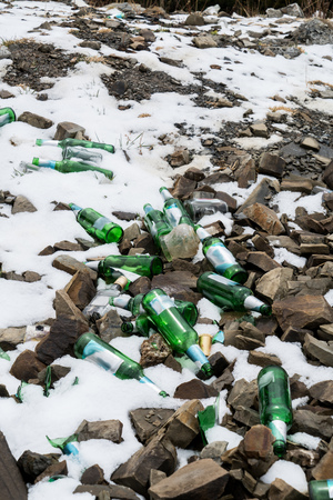 mud snow: bottle in the mud and snow