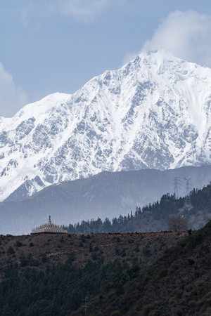 high priest: monastery inclose mountain a famous landmark in Ganzi, Sichuan, China
