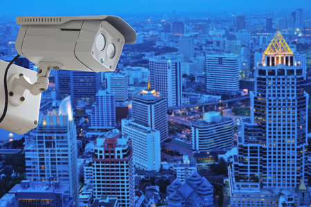 cctv camera isolated on white background with modern building blur background