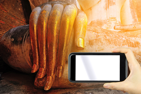 chums: Vintage style. take a photo with smartphoe. gold leaf offerings on slender fingers of wat si chums iconic big buddha statue in sukhothai historic park northern thailand