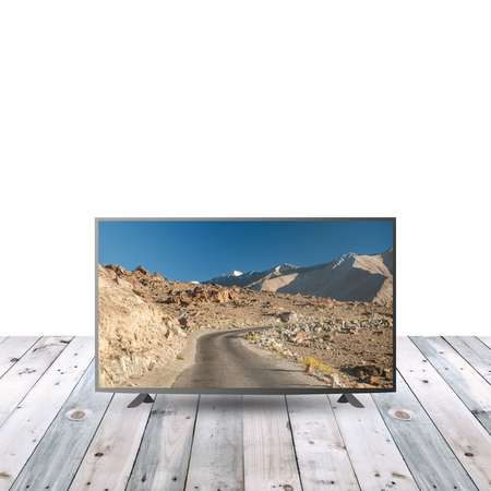 lcd: modern LCD on wooden table with white copy space Stock Photo