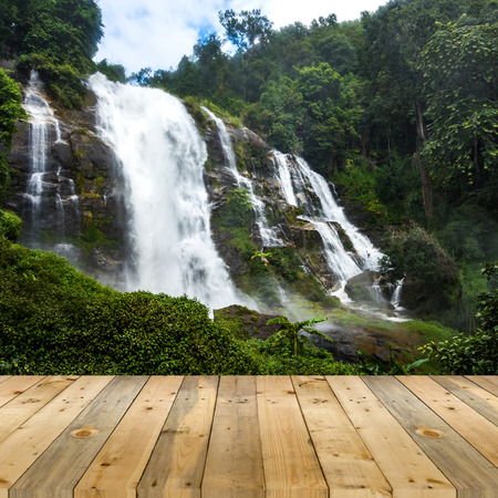 nant: empty wooden plank with Wachirathan waterfall background