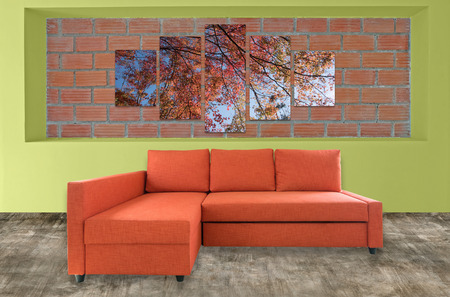 hi resolution: sofa furniture and nature photo collage on brick wall. Hi resolution photo complementary with clipping path Stock Photo