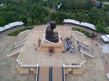 pu: aerial view of sculpture of revered Buddhist monk Luang Pu Thuat at Wat Huay Mongkol in Hua Hin Thailand