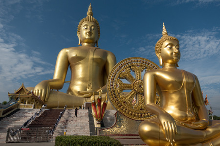The biggest golden buddha statue at Muang temple, Aungthong Thailand Stock Photo