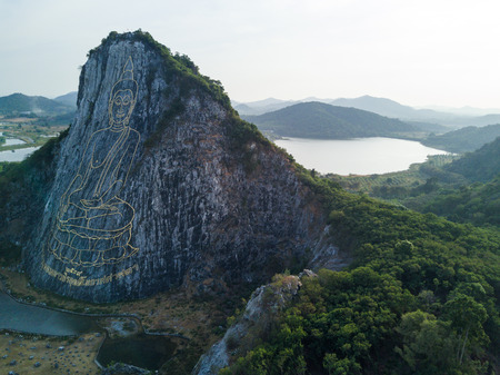 aerial view of Carved buddha image from gold on the cliff at Khao Chee chan, Pattaya, Thailand