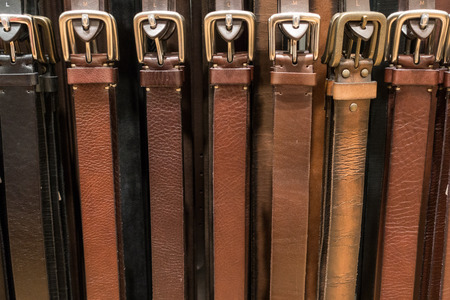 belts hanging in cloth shop