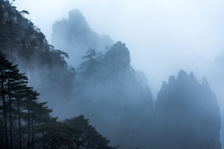 Mountain Huangshan in the mist .  Anhui, China. Stock Photo