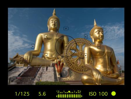 camera viewfinder with travel destination attraction. Wat muang, Angthong. Thailand.