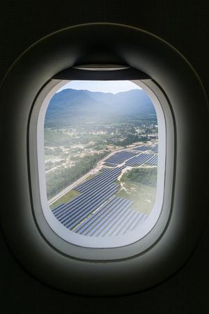 solar farm: The window of airplane with solar farm