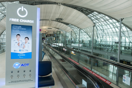 Bangkok,Thailand - January 17,2017: Free charging staion in Suvarnabhumi Airport in Bangkok ,Thailand. This airport is the worlds third largest single building airport terminal designed by Helmut Jahn. Редакционное