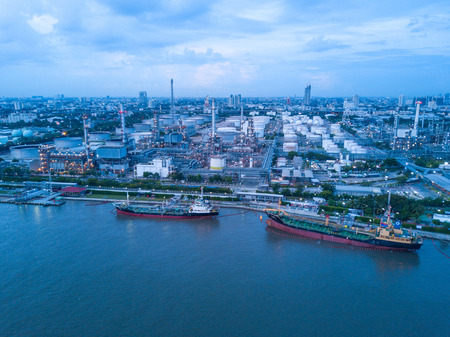 Bangkok Thailand 11 MAY 2017 : aerial shoot of The oil tanker ship was loading the crude oil to The oil refinery near the Chao pra ya river, Bangkok, Thailand.