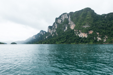 Beautiful mountains and river natural attractions in Ratchaprapha Dam at Khao Sok, Surat Thani Province, Thailand.