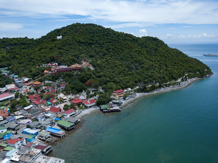 Aerial shot of fishing village at Sichang island is located in the middle of the Gulf of Thailand. Imagens