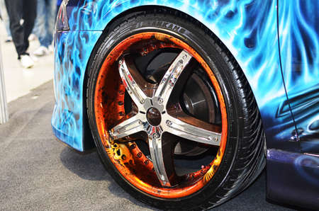 Bucharest, Romania, October 13, 2012 - Custom airbrushed rims on a Skoda Octavia II shown at 4Tuning Fest 2012 auto show Stock Photo - 15927813