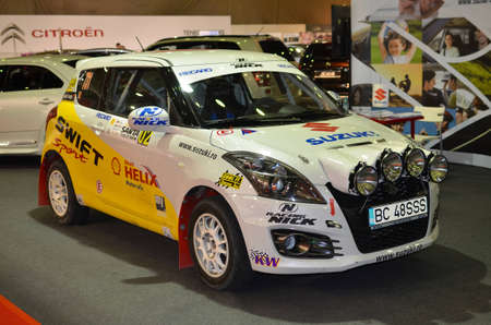 Bucharest, Romania, October 25, 2012 - Suzuki Swift rally car shown at SAB 2012 auto show