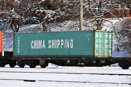 Brasov, Romania - January 14, 2012: China shipping cargo stationed in train station