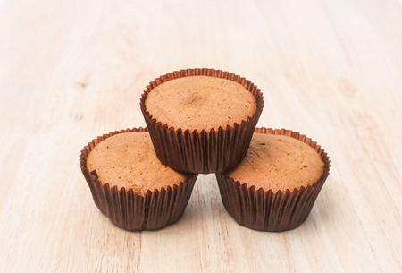 banana cup cake on wooden background photo