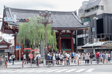senso ji: TOKYO -JUNE 29: Unidentified people passing in front of Senso Ji temple in Asakusa, Tokyo, Japan on JUNE 29, 2015. This temple is Tokyos oldest.