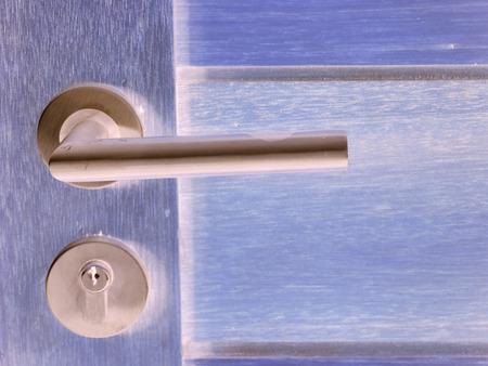scuff: Modern style door handle on natural wooden door