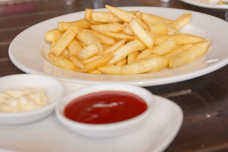 french culture: Close-up of oily French fries as a background