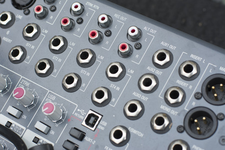 decibels: angled shot of Mackie Digital Mixing Desk Console (black and white)