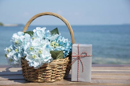 flower baskets: Flower baskets and gift boxes background with copy space. Stock Photo