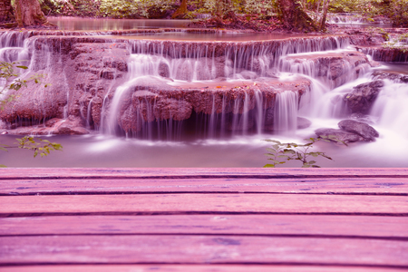 nant: Plank with rock waterfall pink abstract background Stock Photo