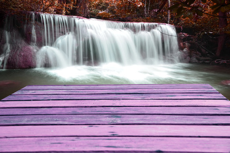 nant: Plank with rock waterfall pink background for display or editing products Stock Photo