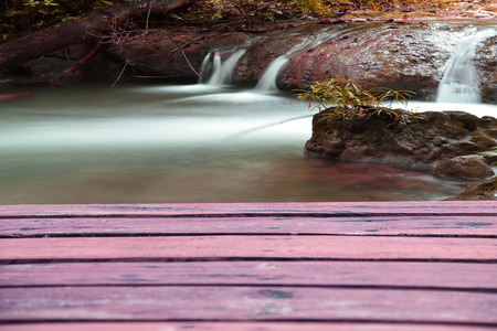 nant: Wooden planks with pink background abstract waterfall. Stock Photo